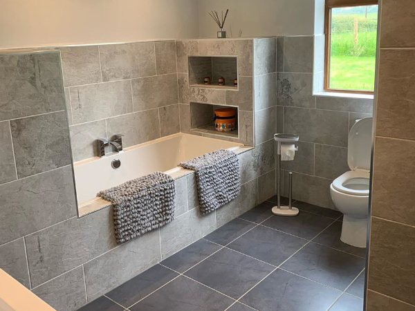 Grey tile bathroom